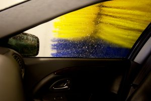 An automatic car wash brush, washing the side of a car
